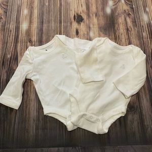 Two white baby gap bodysuits
